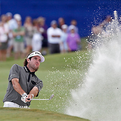 Apr 29, 2012; Avondale, LA, USA; Bubba Watson hits from a bunker on the 18th hole during the final round of the Zurich Classic of New Orleans at TPC Louisiana. Mandatory Credit: Derick E. Hingle-US PRESSWIRE