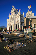 Tourists looking at souvenirs outside La Basilica church; Cartago, Costa Rica.<br />