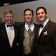 Charles Neal, left, Patrick Maguire, center, and Michael Papagikos pose for a picture during the Diamonds and Champagne Hope Ball Saturday November 22, 2014 at the Coastline Convention Center in Wilmington, N.C. (Jason A. Frizzelle)