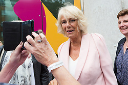 © Licensed to London News Pictures. 09/09/2015. London, UK. Camilla, Duchess of Cornwall poses for a photo with a fan when leaving the ITV studios in London to celebrate the organisation's 60th anniversary. Photo credit : Vickie Flores/LNP