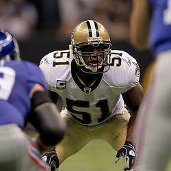 2009 October 18: New Orleans Saints linebacker Jonathan Vilma (51) looks at the New York Giants offense during a 48-27 win by the New Orleans Saints over the New York Giants at the Louisiana Superdome in New Orleans, Louisiana.