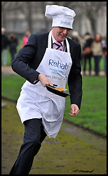 Mike Crockart Lib Dem takes part in the MP's and Lords race against political Journalist in the Rehab Parliamentary Pancake Shrove Tuesday race a charity event which sees MPs and Lords joined by media types in a race to the finish. Victoria Tower Gardens, Westminster, Tuesday February 12, 2013. Photo By Andrew Parsons / i-Images