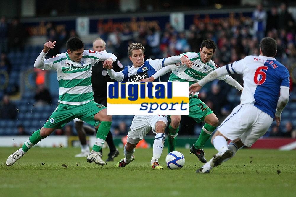 Fellow Norwegians Morten Gamst Pedersen and Petter Vaagan Moen go for the ball between QPR's Alejandro Faurlin and Ryan Nelsen of Blackburn Rovers  at Ewood Park<br /> --------------------<br /> I<br /> FA Cup - 3rd Round<br /> Blackburn Rovers v QPR<br /> 08 January 2011<br /> <br /> Norway only<br /> Queens Park Rangers
