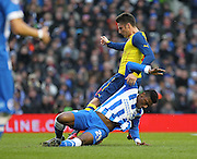 Arsenal's Olivier Giroud battles with Brighton's Rohan Ince during the The FA Cup match between Brighton and Hove Albion and Arsenal at the American Express Community Stadium, Brighton and Hove, England on 25 January 2015. Photo by Phil Duncan.