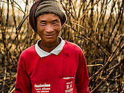 02 FEBRUARY 2016 - NONG LAN, KANCHANABURI, THAILAND: A migrant farm worker from eastern Thailand in a sugar cane field during the harvest in Kanachanaburi province, in western Thailand. Thai sugar cane yields are expected to drop by about two percent for the 2015/2016 harvest because of below normal rainfall. The size of the crop is expected to increase slightly though because farmers planted more sugar cane acreage this year. Thailand is the second leading exporter of sugar in the world. Thai sugar growers are hoping a good crop would make up for shortages in global markets caused by lower harvests in Brazil and Australia, where sugar yields have been stunted by drought. Because of the drought in Thailand, sugar exports are expected to drop by up to 20 percent, contributing to a global sugar shortage. The drought is is also hurting the quality of Thai sugar, because sugarcane grown in drought is less sweet than normal so mills need to process more cane to make the same amount of sugar. Thai sugar farmers have lost 20 percent to 30 percent of their output this year because of the drought.          PHOTO BY JACK KURTZ