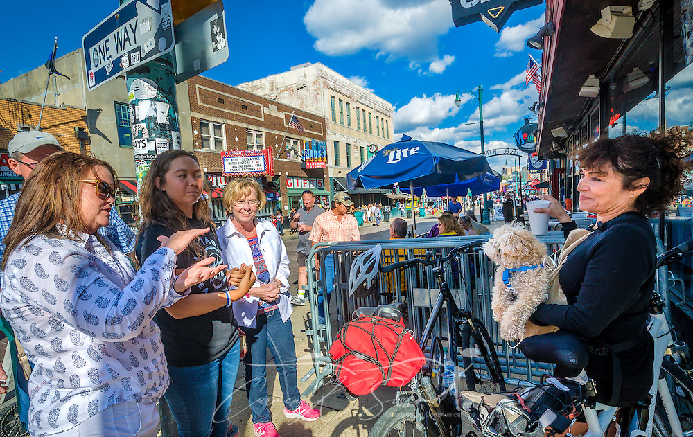 Jackie McDowell talks with curious bystanders as she holds her toy poodle, Sparky, Sept. 12, 2015, in Memphis, Tennessee. McDowell, a resident of Albuquerque, New Mexico, brought Sparky to see the world famous Beale Street. (Photo by Carmen K. Sisson/Cloudybright)