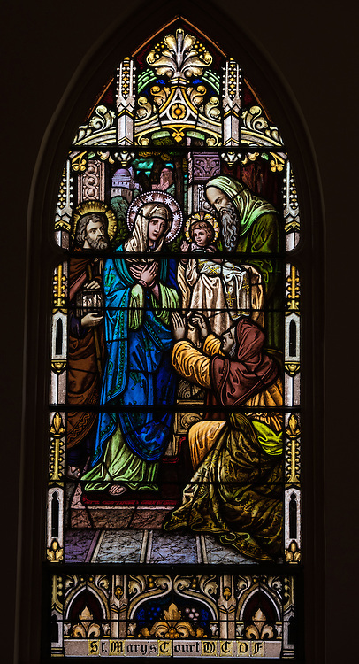 Stained glass window at St. Mary Church in Bear Creek, Wis., depicts Jesus' at the temple with Mary and Joseph. (Sam Lucero photo)