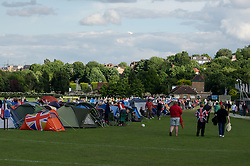 © Licensed to London News Pictures. 24/06/2012. London, UK.  Ticketless people camp overnight in order to queue for tickets for Wimbledon 2012, on the eve of the tournament.  Wimbledon remains one of the very few major UK sporting events where you can still buy premium tickets on the day of play.   The sky is a mixture of blue sky and cloud - the UK has suffered from unseasonably bad weather in recent weeks, with heavy rain across the country and flooding in many parts.   Photo credit : Richard Isaac/LNP