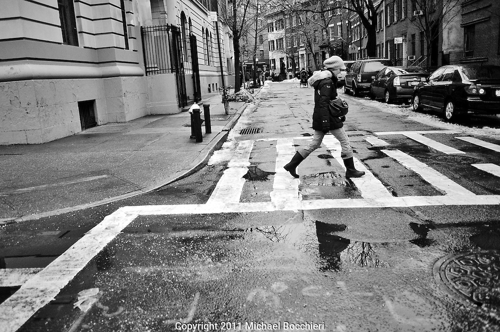 NEW YORK, NY - January 19:  A woman crosses the street on January 19, 2011 in NEW YORK, NY.  (Photo by Michael Bocchieri/Bocchieri Archive)