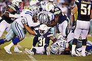 Dallas Cowboys running back Gus Johnson (37) gets gang tackled by San Diego Chargers defensive back Adrian Phillips (31) and teammates as he runs the ball in the third quarter during the 2015 NFL preseason football game against the San Diego Chargers on Thursday, Aug. 13, 2015 in San Diego. The Chargers won the game 17-7. (©Paul Anthony Spinelli)