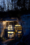 Festus, Missouri: The exterior of the Sleeper cave house at dusk shows how Curt and Deborah Sleeper built a 2,000 square foot home inside a 17,000 square foot cave. There is a forest (and a neighbor's home) on part of the top of their cave. (Photo: Ann Summa).