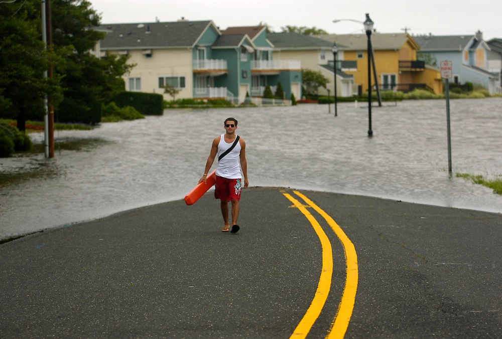 Albert Azar of Deal makes his away from the flooding section of Edgemont Drive and Deal Lake in Loch Arbour caused by Hurricane Irene on August 28.  As Hurricane Irene headed north, the concern was inland flooding of rivers and streams. Photo essay from throughout the Jersey Shore, New Jersey