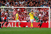 Leeds United defender Liam Cooper (6) looks glum as Brentford forward Sergi Canos (7) scores Brentford    second goal during the EFL Sky Bet Championship match between Brentford and Leeds United at Griffin Park, London, England on 22 April 2019.
