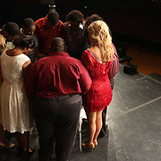 The cast prays together before a performance of Smokey Joe's Cafe Sunday June 15, 2014 at the Scottish Rite Theater in Wilmington, N.C. (Jason A. Frizzelle)