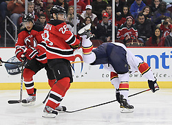 Feb 11; Newark, NJ, USA; New Jersey Devils defenseman Anton Volchenkov (28) hits a Florida Panthers player during the first period at the Prudential Center.
