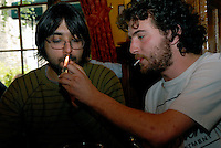 Young university lads in their 20's smoking in a pub before smoking ban.