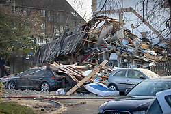 © Licensed to London News Pictures. 27/12/2018. Andover, UK. Damaged cars are seen in the remains of a house in Andover, Hampshire where a man's body has been pulled from wreckage, following an explosion in the property. Residents have been evacuated form the area following a blast in the early hours of this morning. Photo credit: Peter Macdiarmid/LNP
