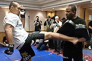 BIRMINGHAM, ENGLAND, NOVEMBER 2, 2011: Mark Munoz (left) works on his striking with Rafael Cordeiro at the media open work-out sessions inside the Hilton Hotel on November 2, 2011.