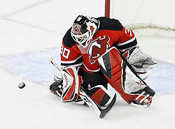 Mar 12, 2009; Newark, NJ, USA; New Jersey Devils goalie Martin Brodeur (30) makes a save during the third period at the Prudential Center. The Devils defeated the Coyotes 5-2, and Brodeur moved to within one win of tying Patrick Roy for the all-time win record.