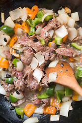 Close up of beef in black bean sauce in wok,