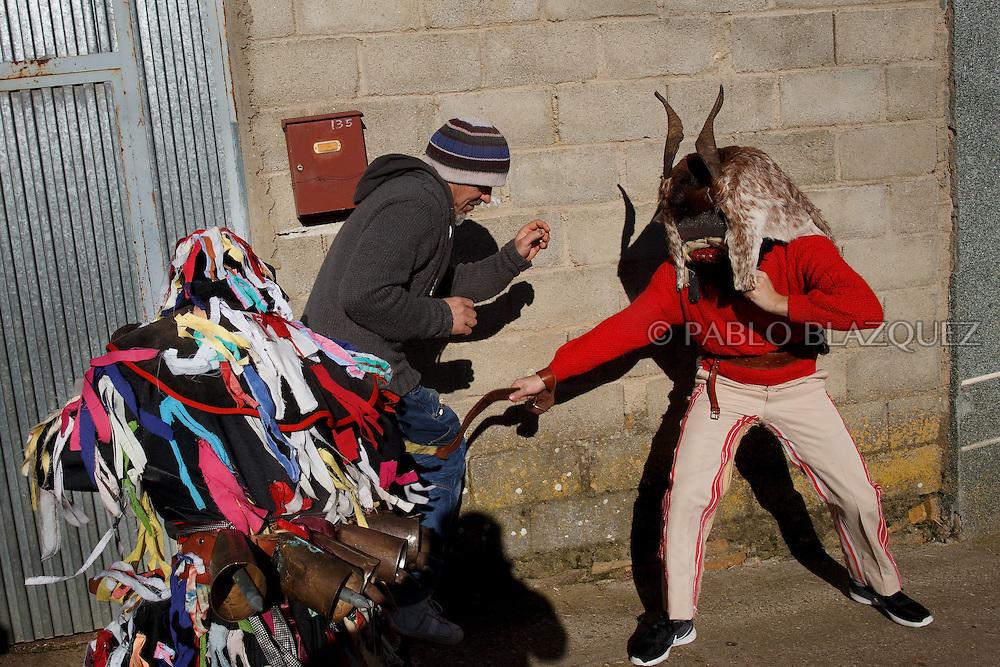 Men dressed as La Filandorra (L) and El Diablo (R) hit a villager in the streets during La Filandorra festival on December 26, 2016 in the small village Ferreras de Arriba, Zamora province, Spain.  La Filandorra festival is a pagan winter masquerade that takes place during Saint Esteban festivities. The parade is represented by four characters, La Filandorra, El Diablo (Devil), La Madama (madame) y El Galán (Gallant). (© Pablo Blazquez)