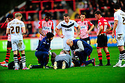 Port Vale's Anthony Grant being treated for an injury during the The FA Cup match between Exeter City and Port Vale at St James' Park, Exeter, England on 6 December 2015. Photo by Graham Hunt.