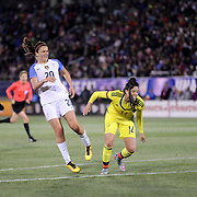 Lindsey Horan, USA, shoots past Nataly Arias, Colombia, during the USA Vs Colombia, Women's International friendly football match at the Pratt & Whitney Stadium, East Hartford, Connecticut, USA. 6th April 2016. Photo Tim Clayton