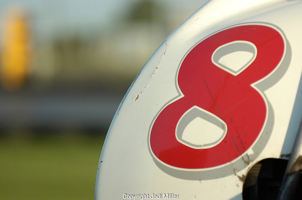 A red number eight on the back of a gocart.