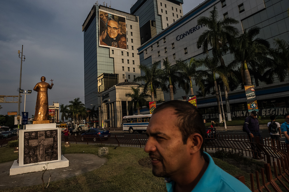 SAN SALVADOR, EL SALVADOR - MAY 20, 2015:   A large painting and a statue of slain archbishop, Monsignor Oscar Romero decorate Salvador del Mundo Plaza in San Salvador where Romero's beatification ceremony will be held on Saturday.  PHOTO: Meridith Kohut for The New York Times