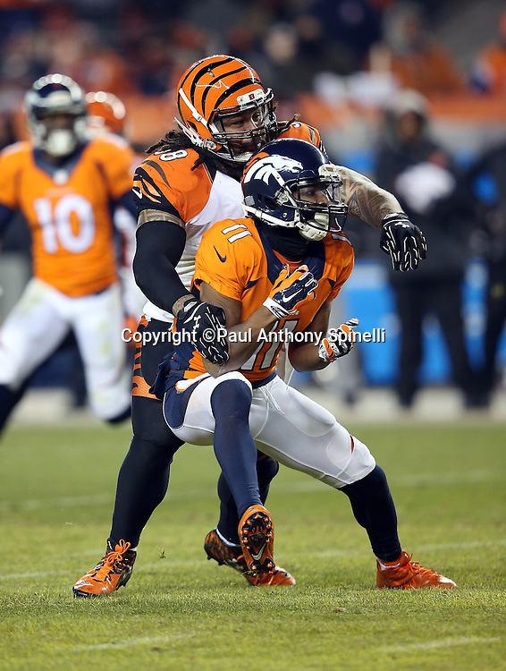 Cincinnati Bengals middle linebacker Rey Maualuga (58) plays tight pass coverage on Denver Broncos wide receiver Jordan Norwood (11) as he breaks up a pass during the 2015 NFL week 16 regular season football game against the Denver Broncos on Monday, Dec. 28, 2015 in Denver. The Broncos won the game in overtime 20-17. (©Paul Anthony Spinelli)