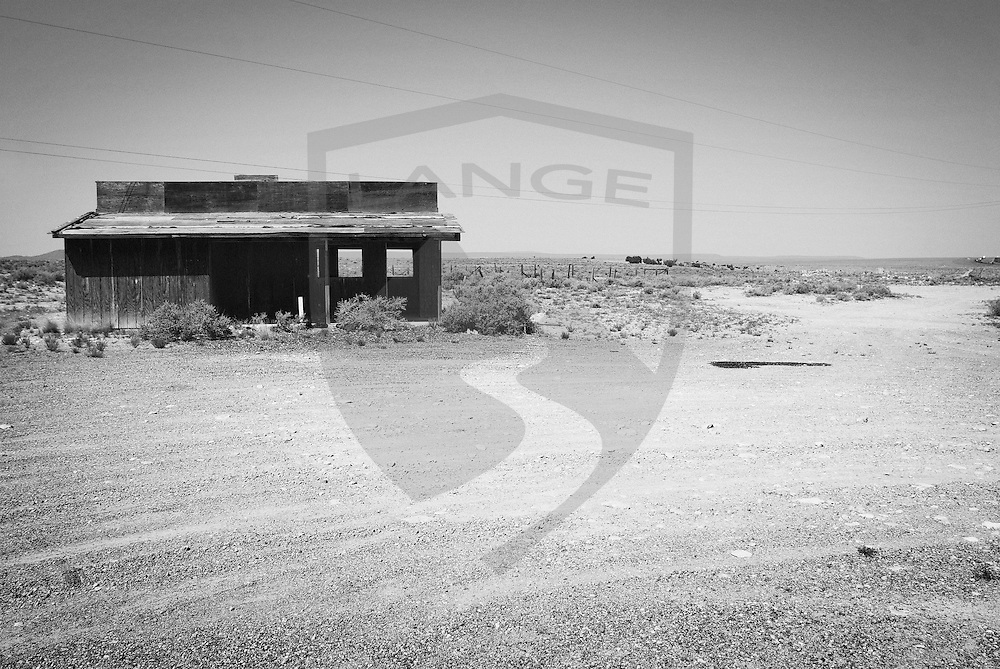 arizona deserted dirt road wood building landscape architecture in black and white at two guns ghost town along route 66 just east of flagstaff.  two guns was a popular tourist destination before the creation of interstate 40 bypassed the town.