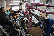 Queens, N.Y., November 5, 2013. While leading a bike repair workshop in Spanish to a group of moms in Queens, Jose shows participants how to fix the breaks. 11/05/2013. Photo by Erin Brodwin/NYCity Photo Wire