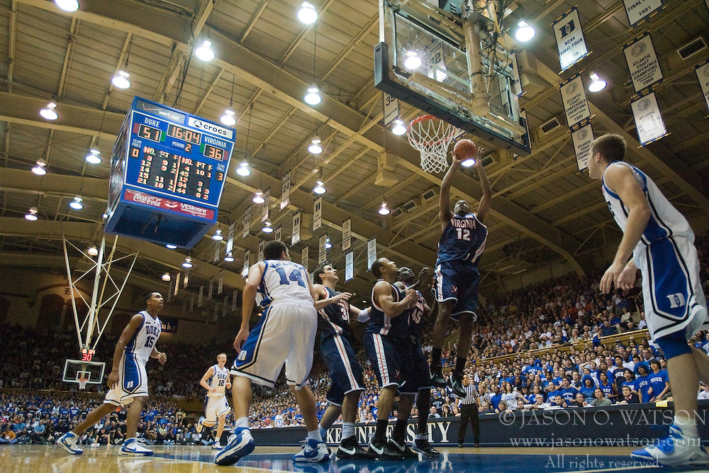 Virginia forward Jamil Tucker (12) scores against Duke.  The Duke Blue Devils defeated the Virginia Cavaliers 87-65 in men's basketball at Cameron Indoor Stadium on the campus of Duke University in Durham, NC on January 13, 2008.