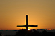 The sun sets behind a cross at Lifest. (Sam Lucero photo)
