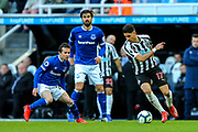 Ayoze Perez (#17) of Newcastle United turns on the ball under pressure from Bernard (#20) of Everton during the Premier League match between Newcastle United and Everton at St. James's Park, Newcastle, England on 9 March 2019.