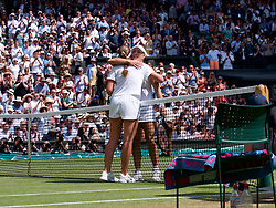 LONDON, ENGLAND - Thursday, July 12, 2018: Angelique Kerber (GER) embraces Jelena Ostapenko (LAT) after her 6-3, 6-3 victory during the Ladies' Singles Semi-Final match on day ten of the Wimbledon Lawn Tennis Championships at the All England Lawn Tennis and Croquet Club. (Pic by Kirsten Holst/Propaganda)