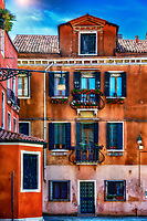 """Late afternoon light illuminates the saturated colors of Venice""...<br />