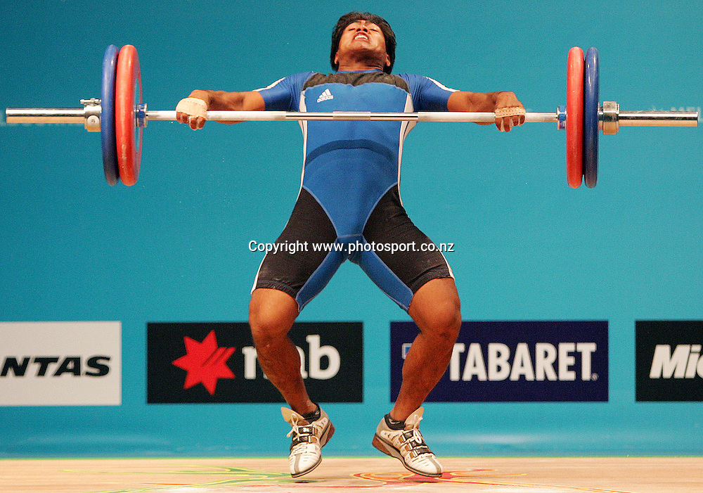 David Katoatau (KIR) competes in the Men's 77kg Weightlifting competition on Day 4 of the XVIII Commonwealth Games at the Exhibition Centre, Melbourne, Australia on Sunday 19 March, 2006. Photo: Hannah Johnston/PHOTOSPORT