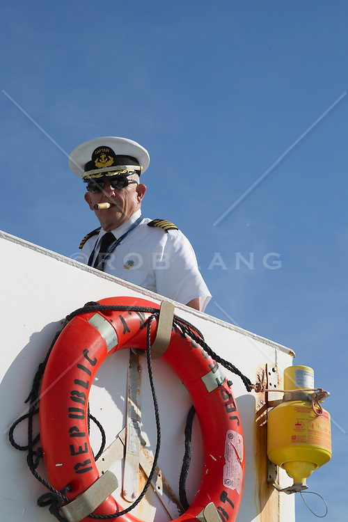 Captain on a ship smoking a cigar