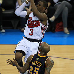 28 January 2009:  New Orleans Hornets guard Chris Paul (3) shoots over Denver Nuggets guard Anthony Carter (25) during a 94-81 win by the New Orleans Hornets over the Denver Nuggets at the New Orleans Arena in New Orleans, LA. The Hornets wore special throwback uniforms of the former ABA franchise the New Orleans Buccaneers for the game as they honored the Bucs franchise as a part of the NBA's Hardwood Classics series. .