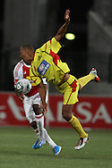 CAPE TOWN, SOUTH AFRICA - 11 FEBRUARY 2011, Wayne Arendse of Santos loses balance while attempting to head the ball clear as Thembinkosi Fanteni of Ajax Cape Town looks onduring the Absa Premiership match between Santos and Ajax Cape Town held at Athlone Stadium in Cape Town, South Africa..Photo by: Shaun Roy/Sportzpics