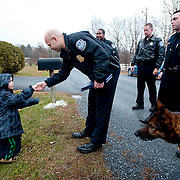 Nathan Norman shakes hands with U.S. Boarder Patrol Officer J.D. Aguilar before being sworn in as an agent.  Nathan has had hundreds of officers and other first responders from all over the country visit him at him home.