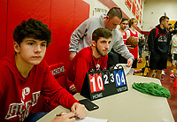 "Volunteers Ryan Chandler and Jakob Steele keep score for Court 3 during the ""Ballin' for Bob"" Tournament for Hope at LHS Saturday.  (Karen Bobotas/for the Laconia Daily Sun)"