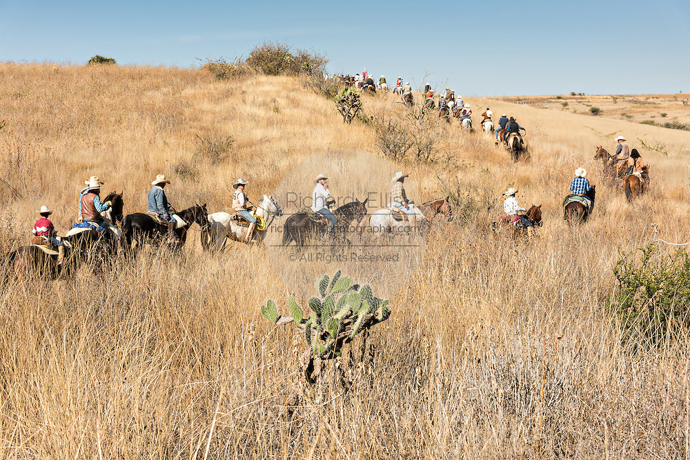 Hundreds of Mexican cowboys snake through the high desert during the annual Cabalgata de Cristo Rey pilgrimage January 5, 2017 in La Trinidad, Guanajuato, Mexico. Thousands of Mexican cowboys and horse take part in the three-day ride to the mountaintop shrine of Cristo Rey stopping along the way at shrines and churches.