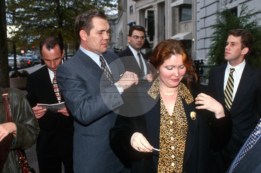 Russian right-wing politician Gen. Alexander Lebed helps his wife Inna with her coat during a visit to November 22, 1996 to Washington, DC. Lebed was recently fired as Russia's national security chief by President Boris Yeltsin.