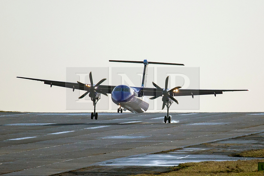 © Licensed to London News Pictures. 16/12/2019. Leeds UK. A Flybe aircraft arriving from Belfast struggles in strong crosswinds at Leeds Bradford airport as bad weather continues to affect the north of England. Photo credit: Andrew McCaren/LNP