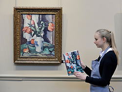 Pictured: Romey Clark from Bonham's auctioneers with the highlight of the sale, Samuel Peploe's 'Tulips in a chinese vase' estimated at £220-280,000 GBP.<br /> <br /> © Dave Johnston / EEm