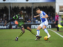Lee Brown of Bristol Rovers is challenged by Rodney Kongolo of Doncaster Rovers - Mandatory by-line: Neil Brookman/JMP - 23/12/2017 - FOOTBALL - Memorial Stadium - Bristol, England - Bristol Rovers v Doncaster Rovers - Sky Bet League One