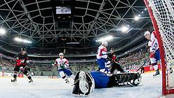 Andrej Hocevar of Slovenia covers a puck during ice-hockey match between Slovenia and Japan at IIHF World Championship DIV. I Group A Slovenia 2012, on April 16, 2012 at SRC Stozice, Ljubljana, Slovenia. (Photo By Matic Klansek Velej / Sportida.com)