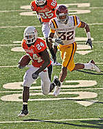 Nov 01, 2008; Stillwater, OK, USA; Oklahoma State Cowboys running back Kendall Hunter (24) rushes past Iowa State Cyclones defensive back Ter'ran Benton (32) in the third quarter at Boone Pickens Stadium.  The Oklahoma State Cowboys won 59-17.